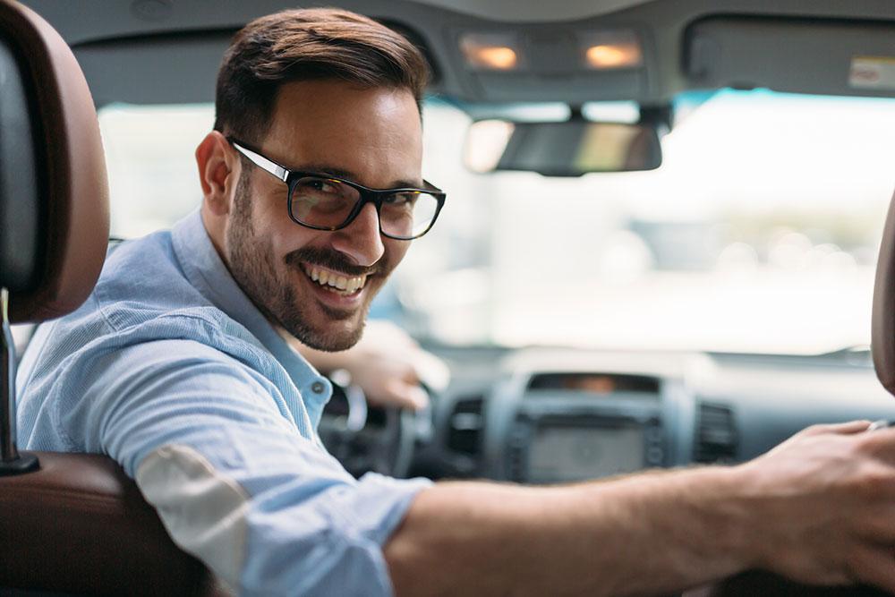 first car loan driving away