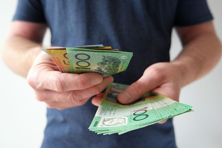 man with australian cash